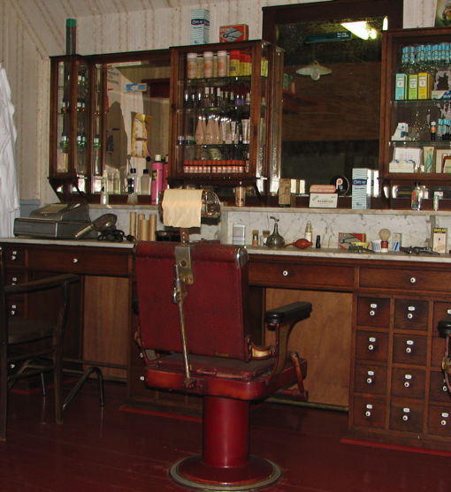A barbershop in Amsterdam in the early 20th century. It is only missing the adverts for Durex on the mirror. By Mork, via Wikimedia Commons.