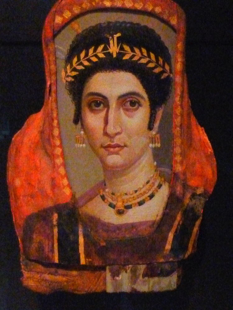 Anonymous, Funerary Portrait of a Woman 'Isidora' (c 100 - 110 CE), encaustic on panel, Getty Villa, Los Angeles. By Dave & Margie Hill / Kleerup from Centennial, CO, USA (Getty Villa - Collection  Uploaded by Marcus Cyron), via Wikimedia Commons.