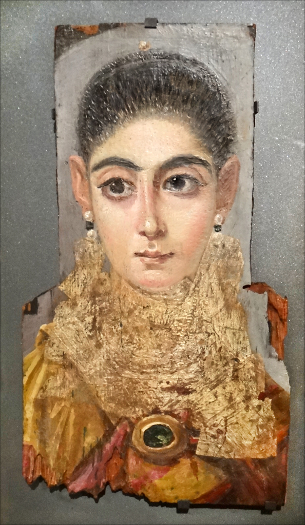Anonymous, Funerary Portrait of a Woman 'The European' (c 80 - 200 CE), encaustic on cedar panel, 42 x 24 cm, Musée du Louvre, Paris. By dalbera from Paris, France, via Wikimedia Commons.