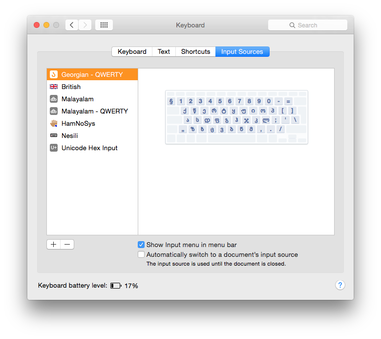 The Input Sources tab in Keyboard sets up those keyboard layouts to be accessed through the menu.